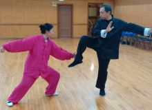 Master Leung practices with student - Tian Liang
