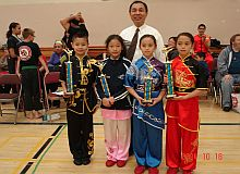 Master Leung taking pictures with some of the young winning competitors at 2014 Canadian Kung Fu Championship